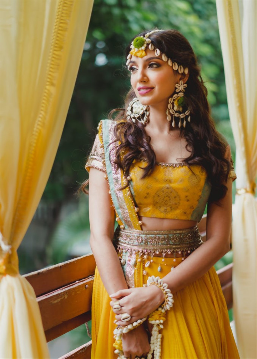 Bride in a yellow gown with a half up half down hairstyle