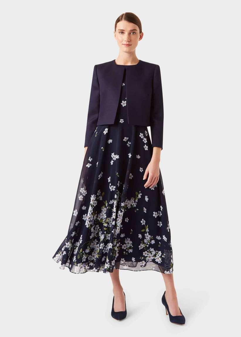 Navy dress with white flowers with a cropped navy jacket