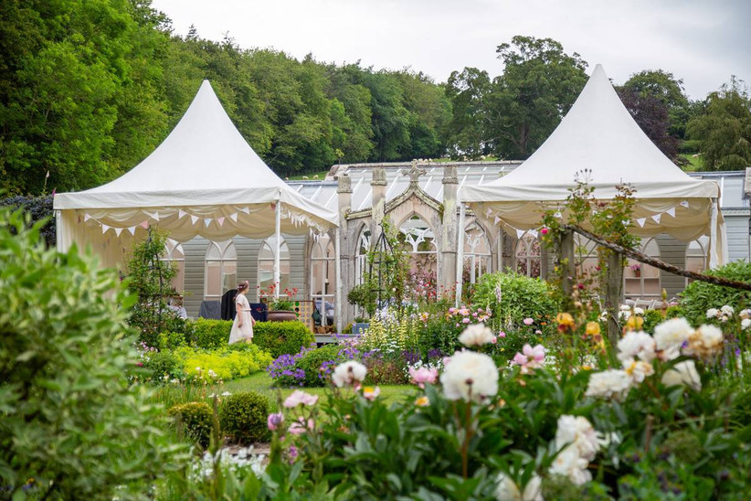 Country garden with wedding ceremony set up