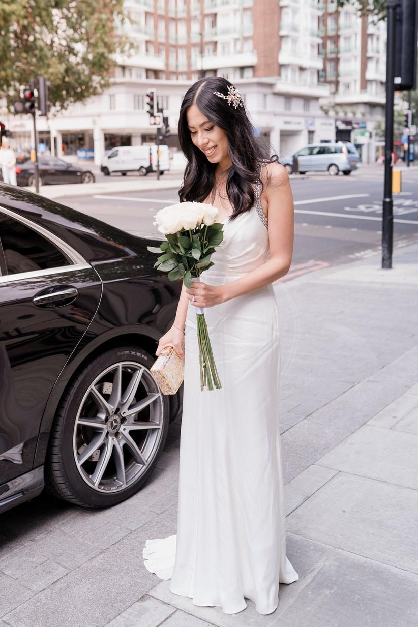 Bride next to a car