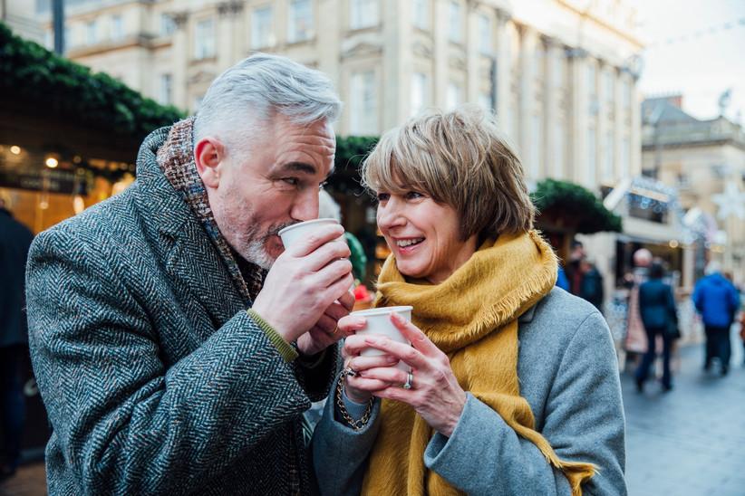 Mature couple celebrating wedding anniversary at christmas market