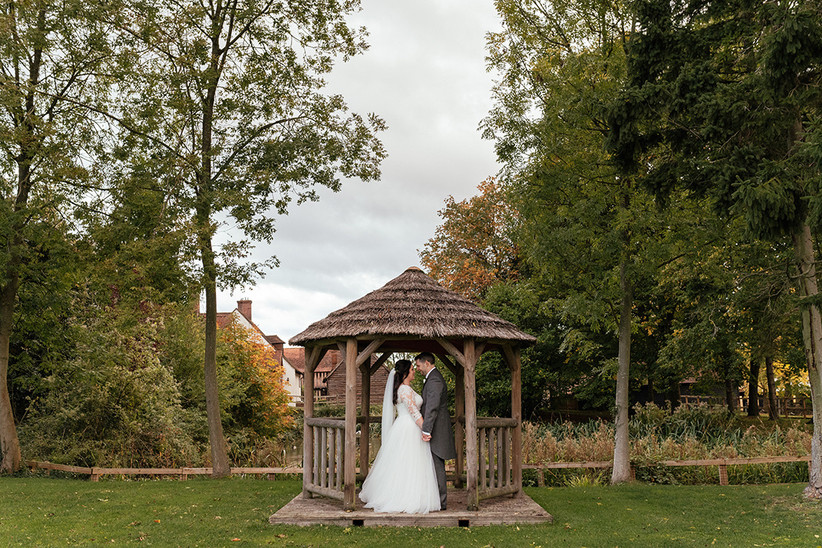 Becky and Ben holding hands under a pergola