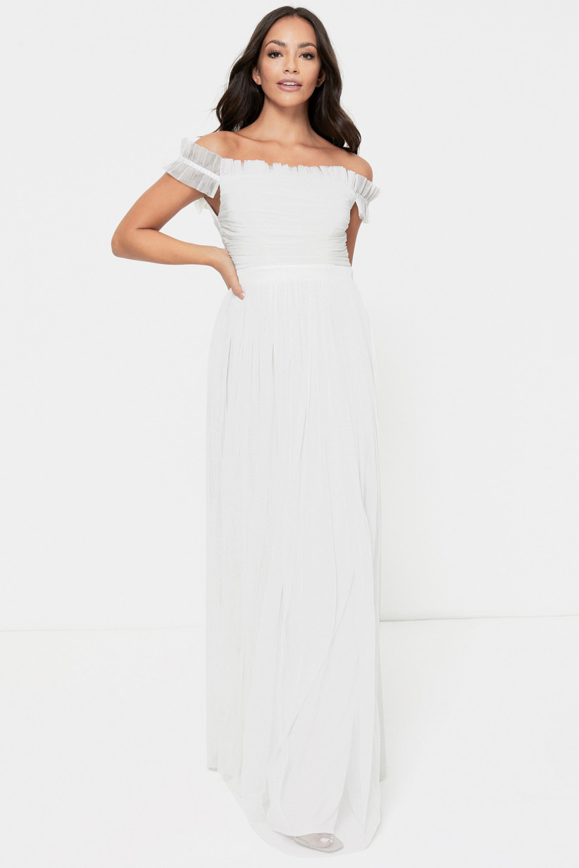Girl wearing a Bardot tulle white wedding dress
