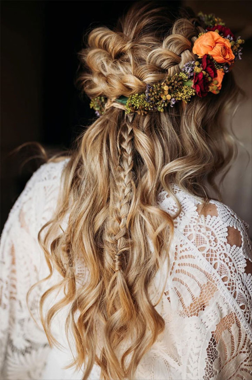 Wavy hair with plaits and a floral head band