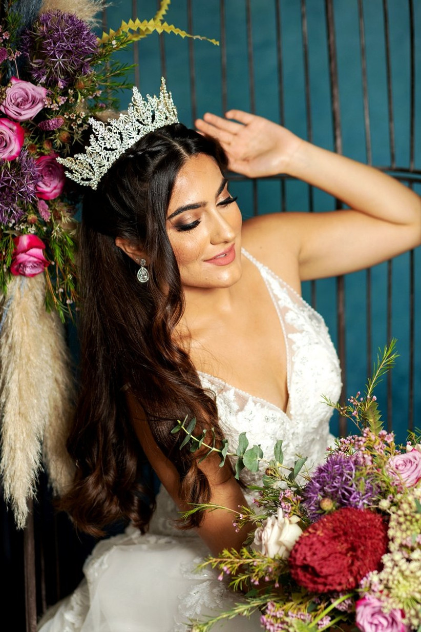 Bride wearing a tiara holding bright flowers