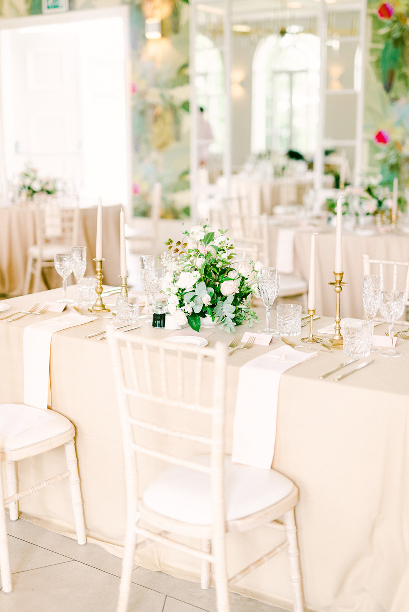 Rectangular wedding table with flowers and candles