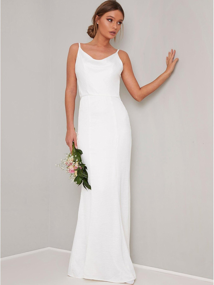 Model wearing a white cowl neck bridesmaid dress