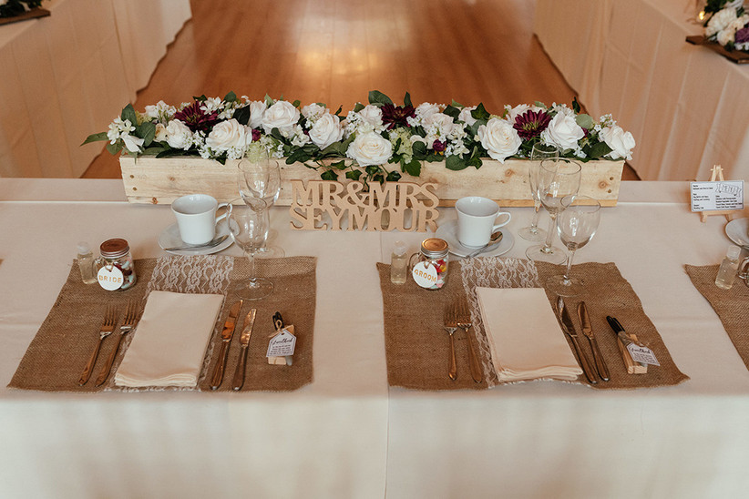 Place settings on the top table including hemp place settings