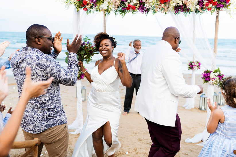 Wedding guests dancing on a beach