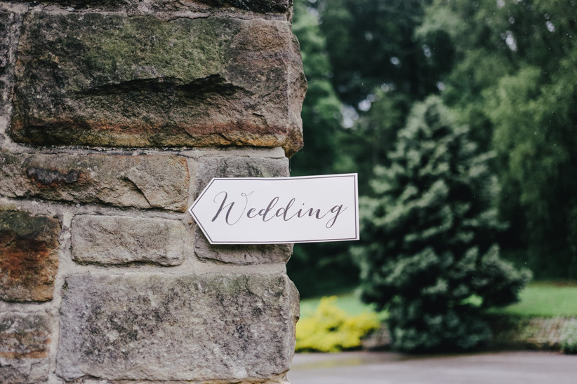 An italic sign pointing guests towards a wedding venue