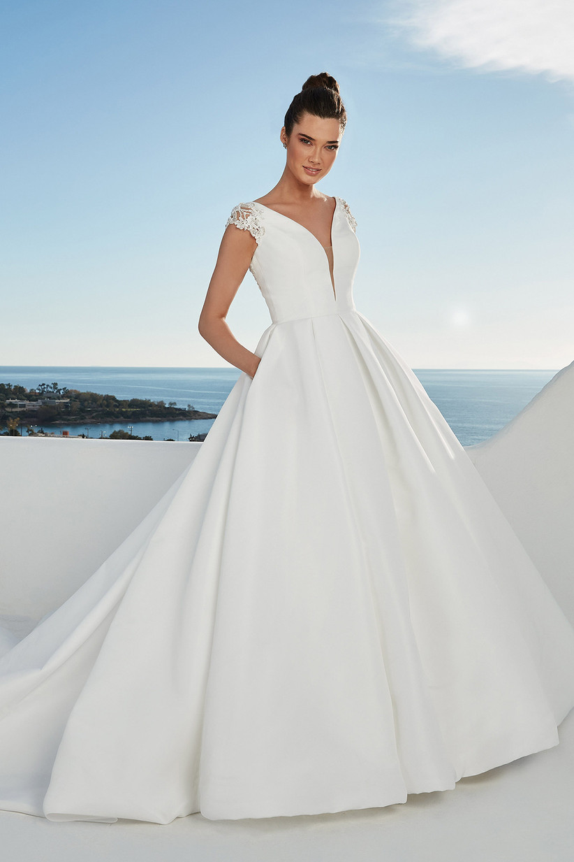 White Justin Alexander ballgown with lace shoulders and a plain skirt