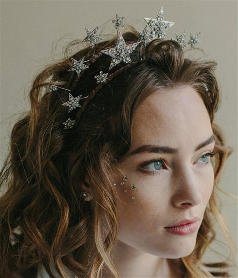 Girl with a star headband and sequins along her cheekbones