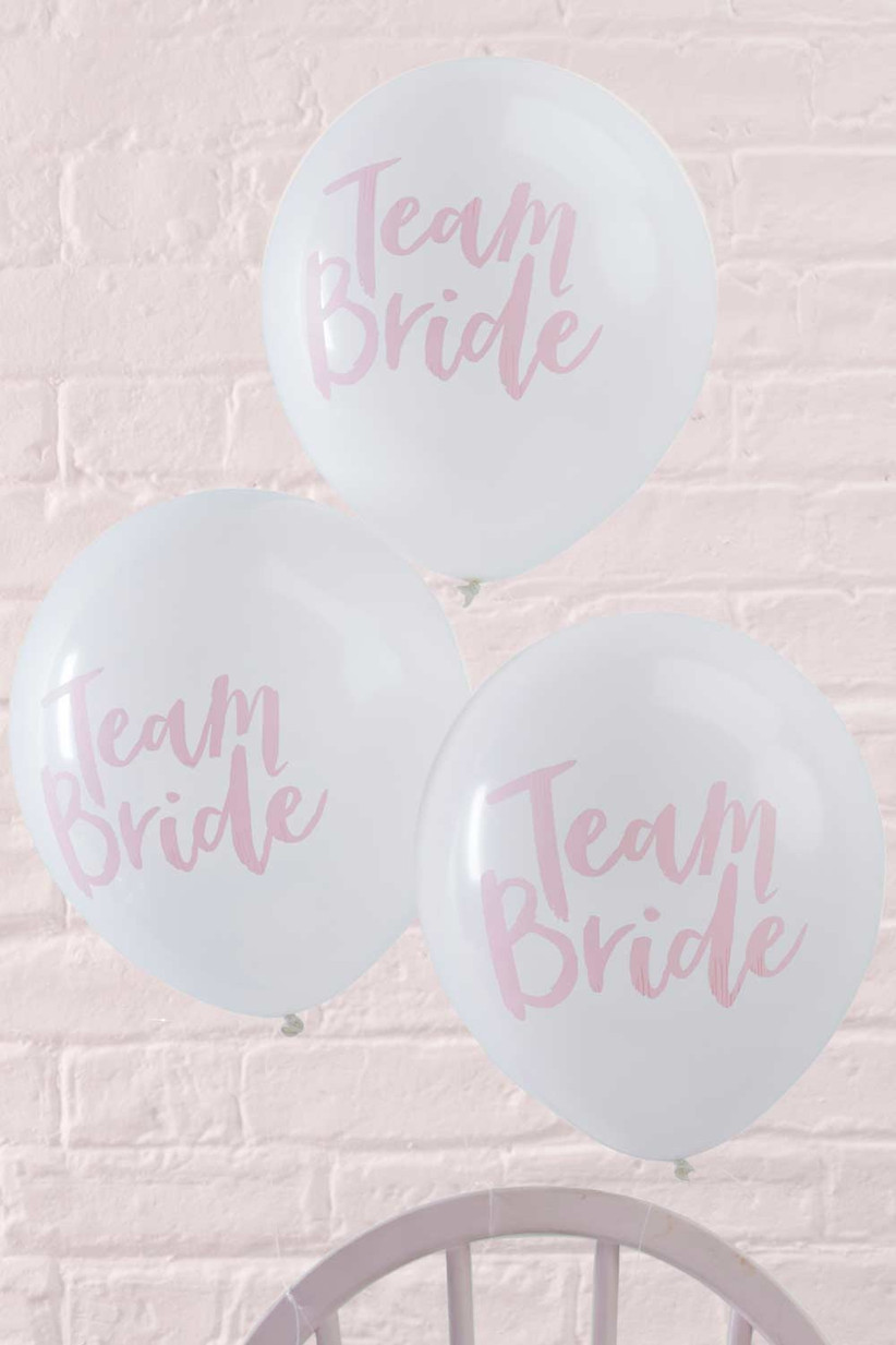 White and pink 'team bride' balloons