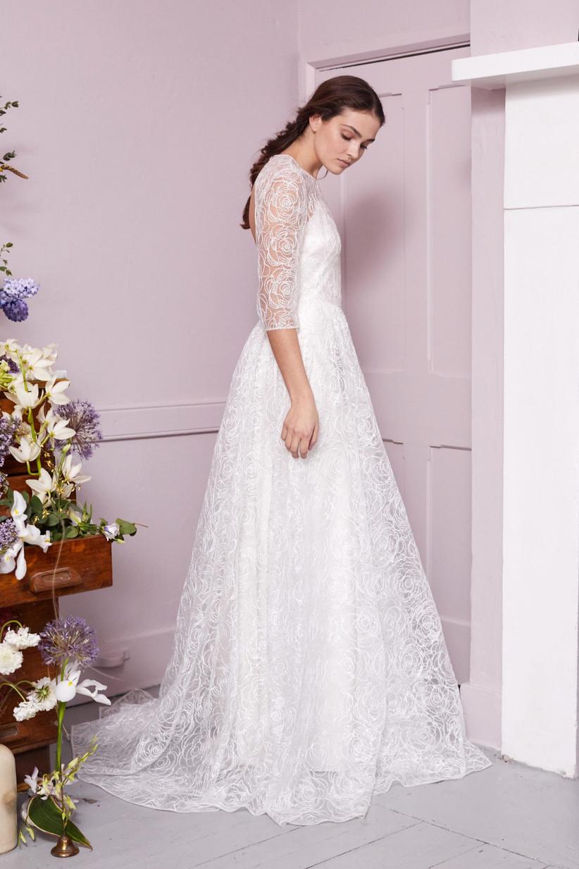 Model wearing a lace three quarter sleeve wedding dress