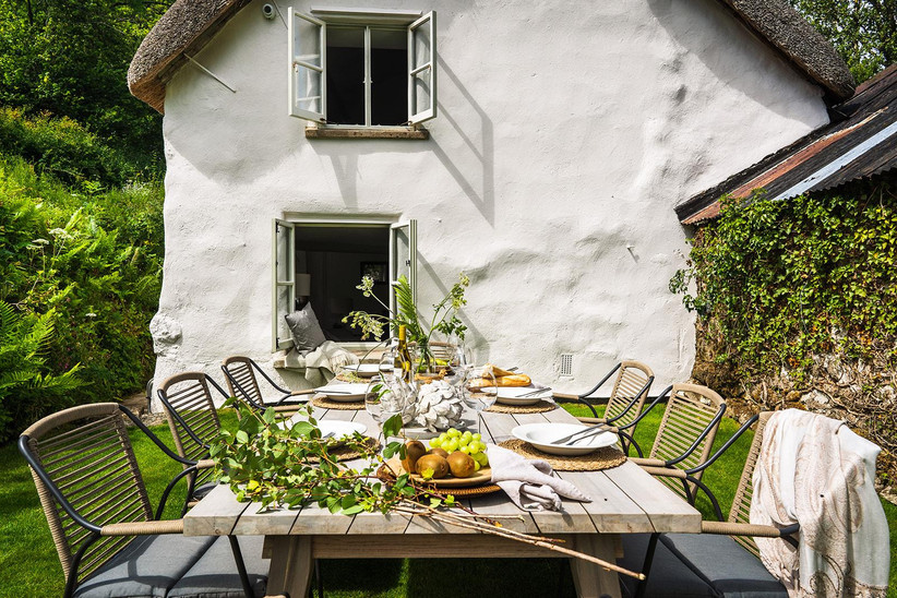 Cottage garden with a table and chairs