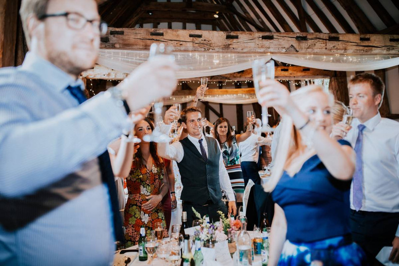 wedding guests raising a toast during wedding speeches