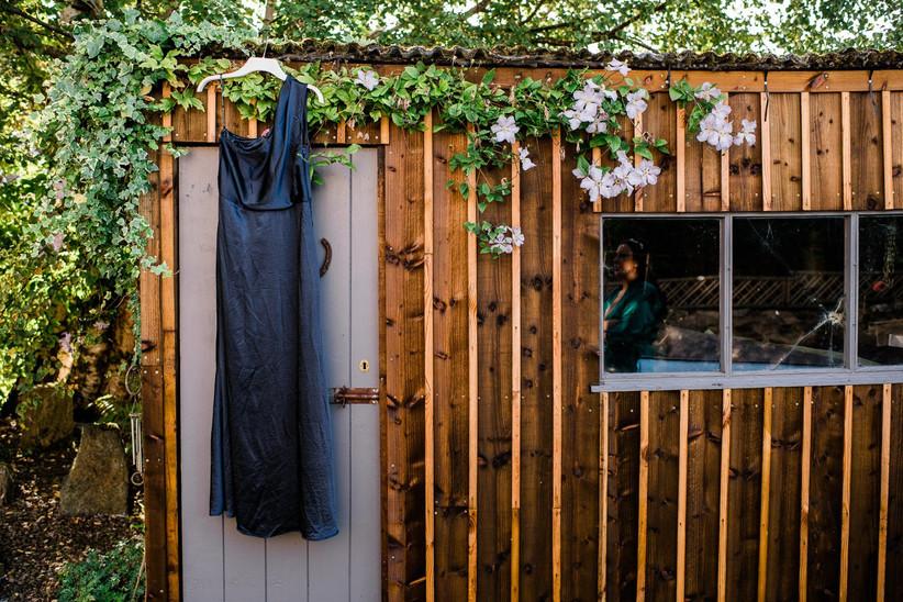 Caitlin's bridesmaid's dress on a hanger