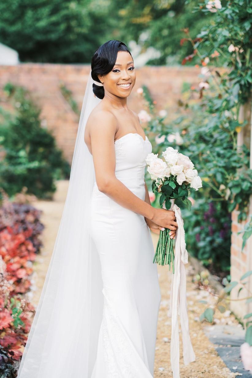 Bride in a garden holding a bouquet