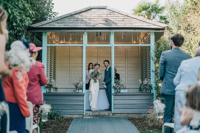 Bride and groom in a wooden pavilion