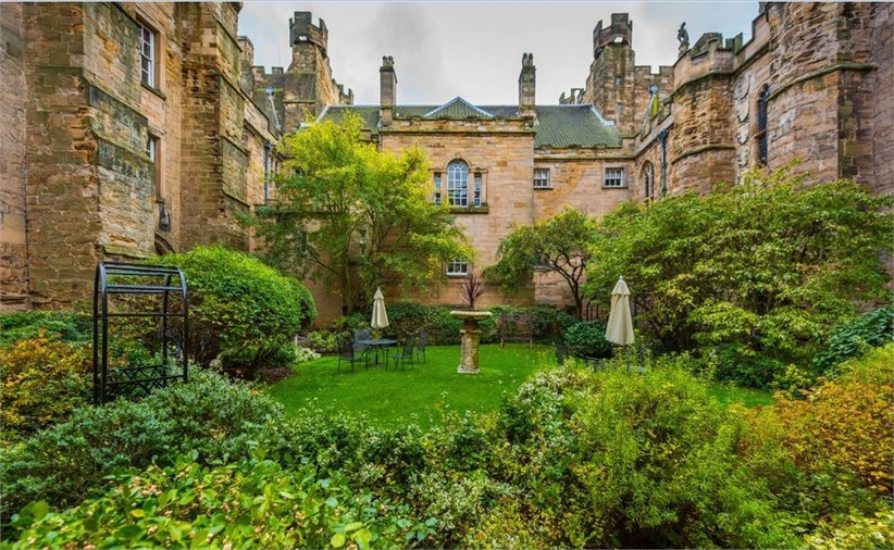 Castle gardens with umbrellas and bushes
