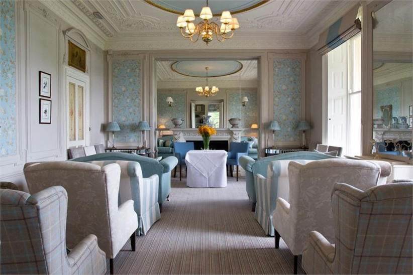 blue-toned-ceremony-room-with-laura-ashley-decor-at-belsfield-hotel