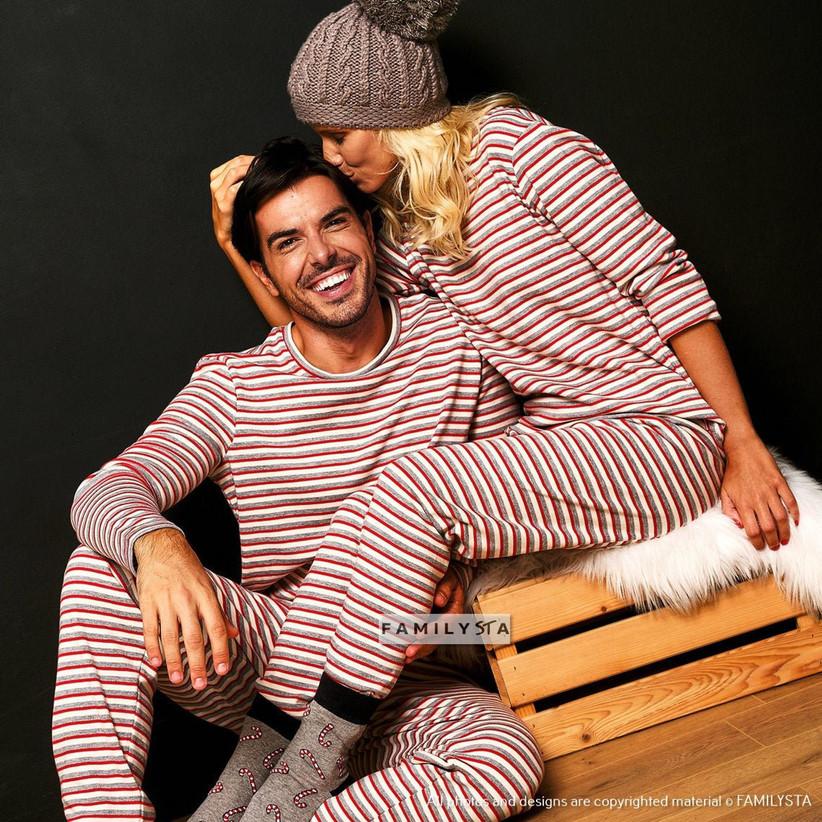 Couple wearing striped pyjamas