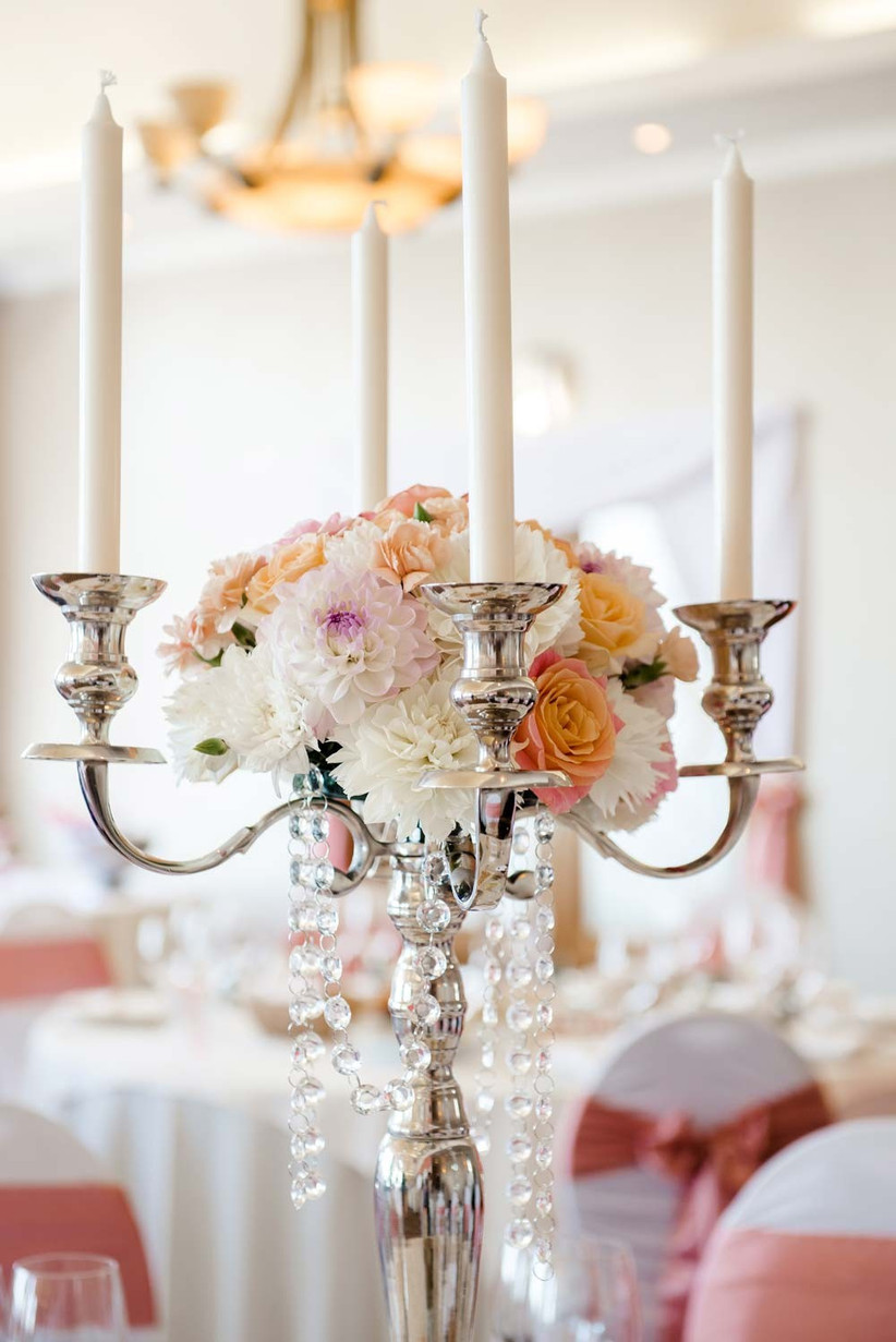 add-seasonal-wedding-flowers-to-a-candelabra-for-a-unique-summer-wedding-centrepiece-idea