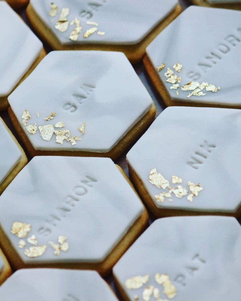 White hexagon biscuits with gold leaf