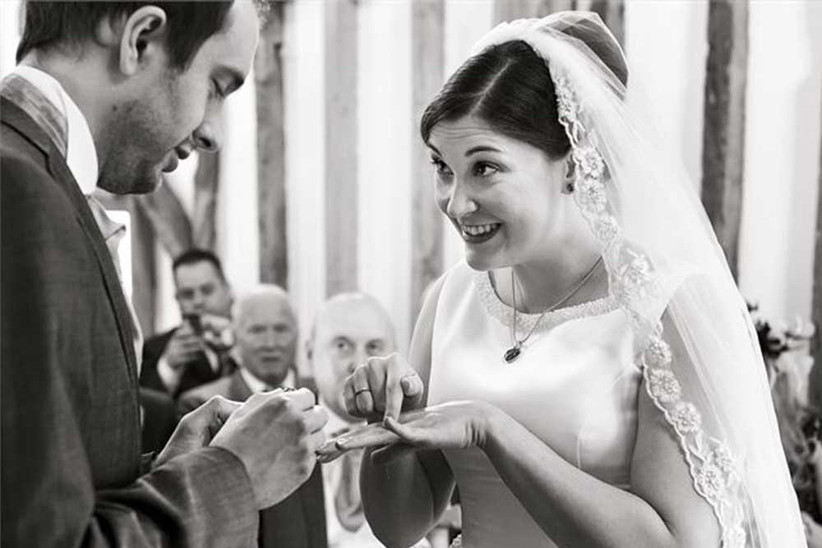 couple-exchanging-rings-in-ceremony-2
