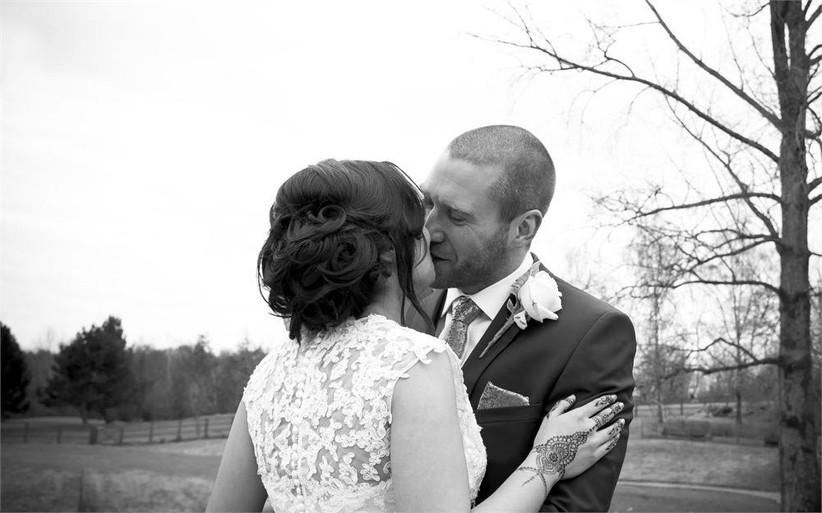 groom-smiling-as-he-kisses-his-bride-2