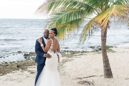 A Pink-Themed, Beachfront Jamaican Destination Wedding with a Sand Ceremony + Julie Vino Dress