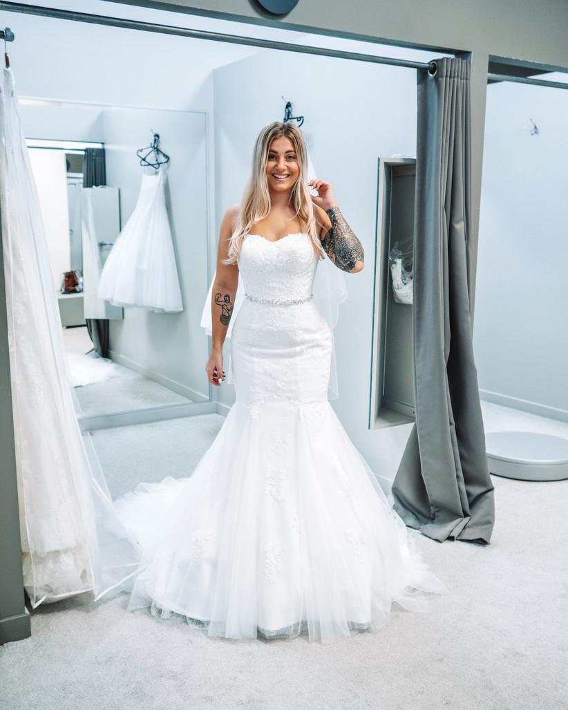 The writer wearing a wedding dress