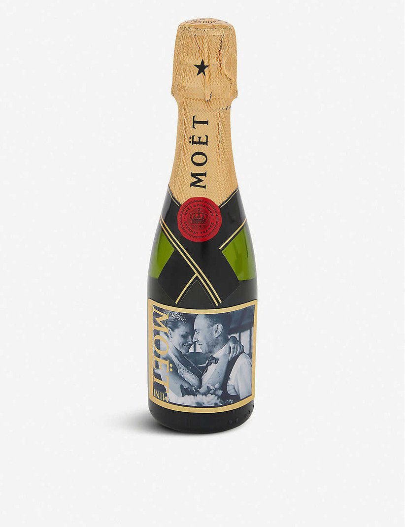 Mini bottle of Moet champagne with a personalised black and white photo label of a couple hugging on their wedding day