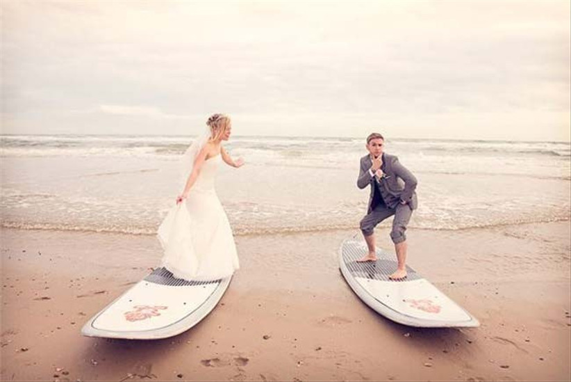 pose-on-surfboards-at-your-beach-themed-wedding-we-love-this-shot-by-one-thousand-words-photography
