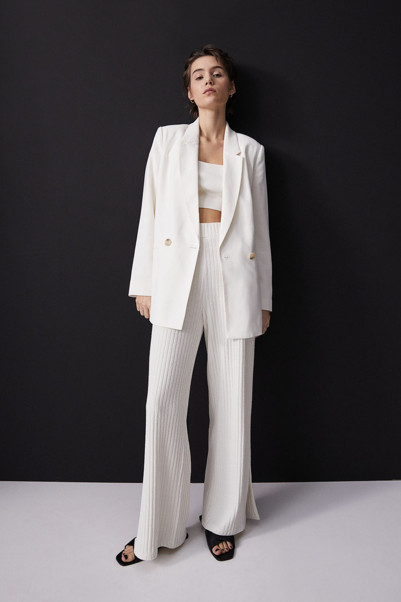 Girl wearing a white blazer with ribbed white trousers