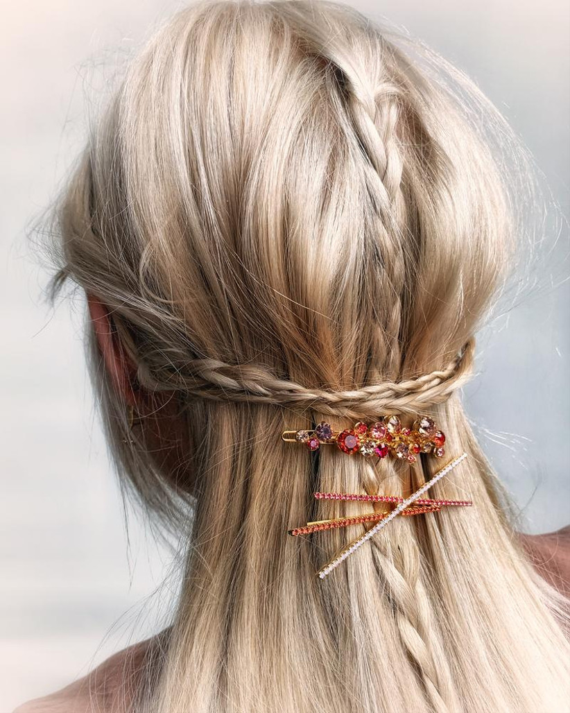 Double plaited half up half down hairstyle with crystal slides