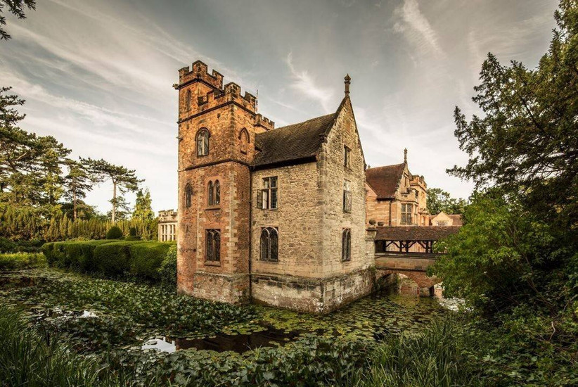 Country house surrounded by a lily-filled moat