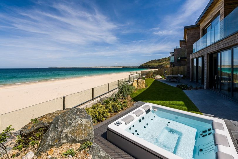 Hot tub overlooking the view of a beach