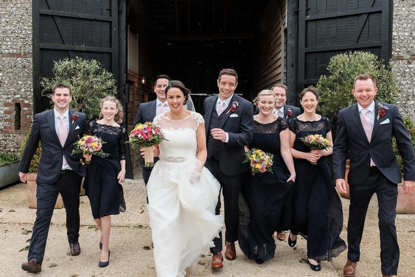 bride-bridesmaids-and-groomsmen-with-colourful-spring-wedding-flowers