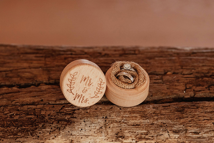 Wedding rings in a round wooden box with hemp inside