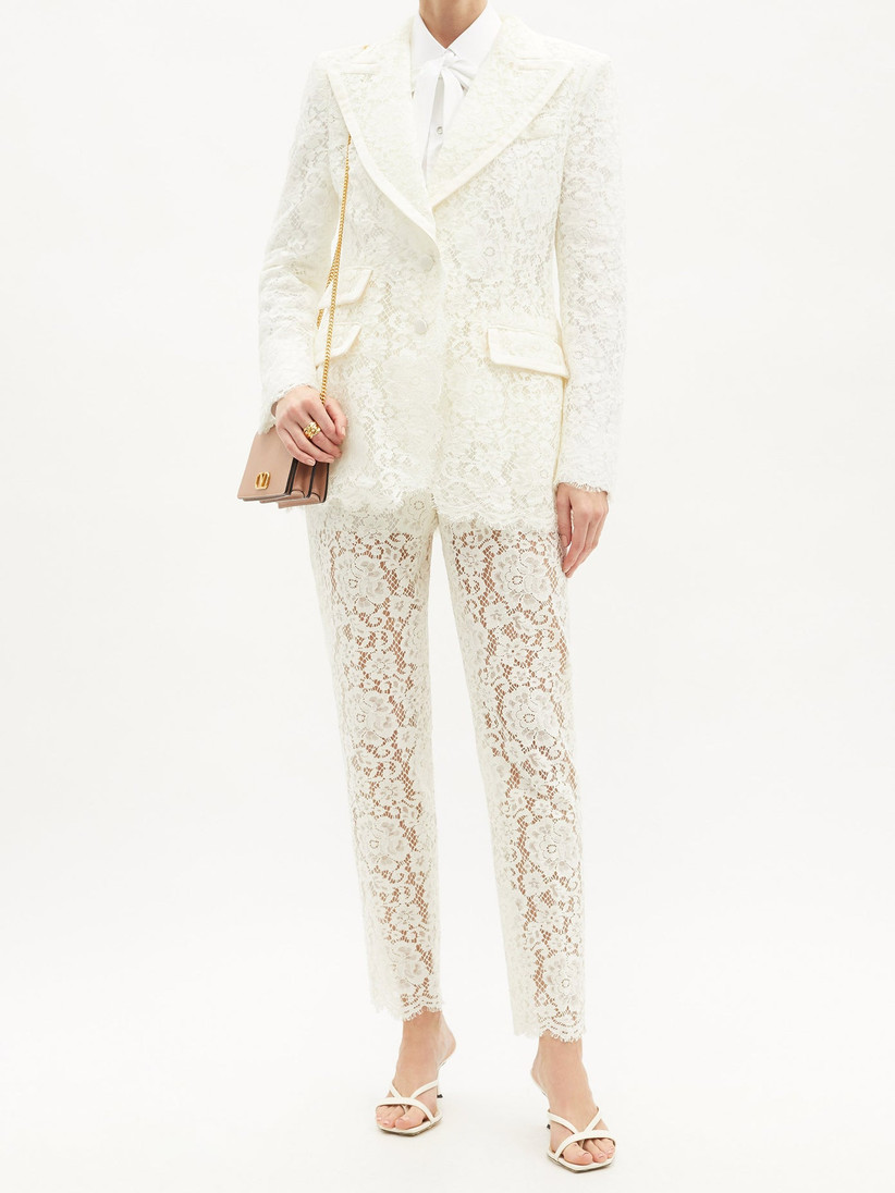 Girl wearing a lace white suit
