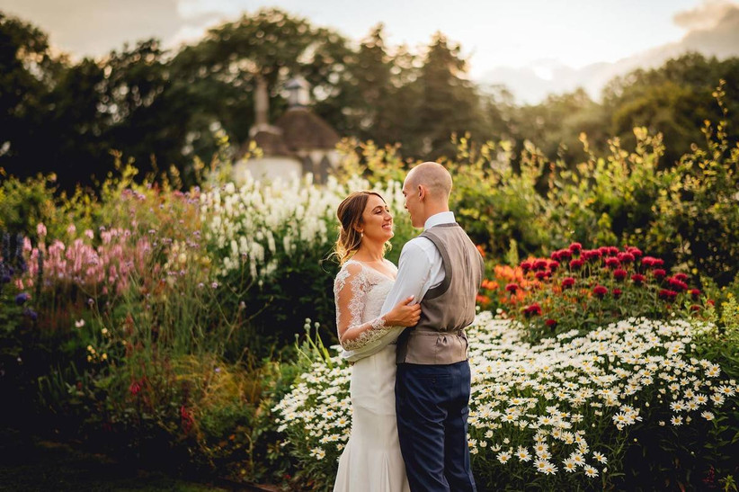 Bride and groom surrounded by wild flowers