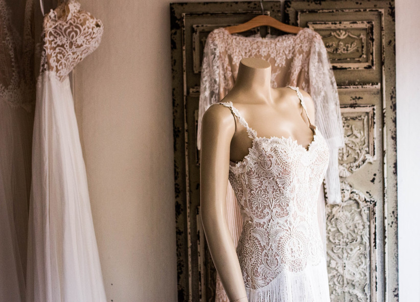 White lace wedding dress on a mannequin