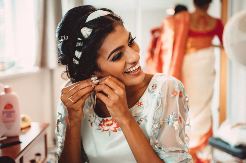 Nirosha putting her earrings in