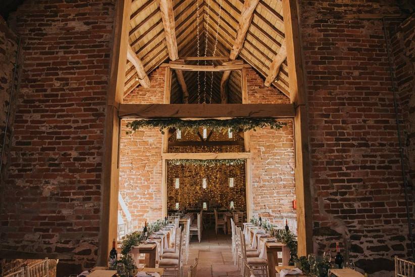 Fairy light decorated barn wedding venue