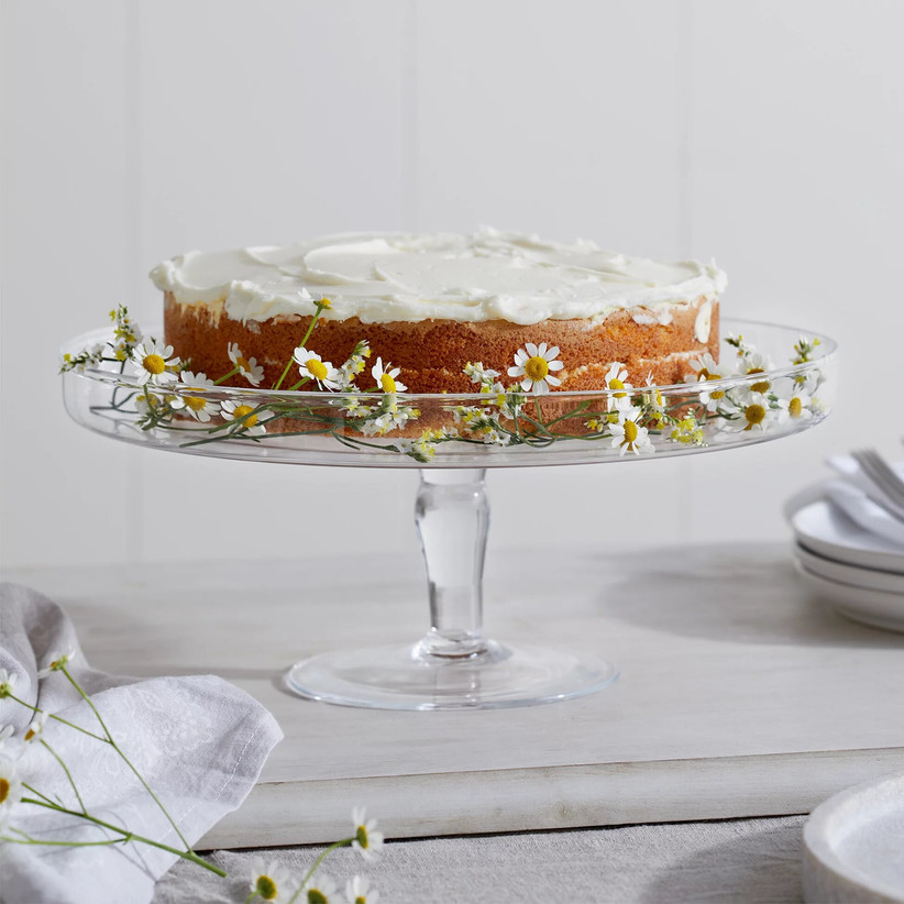 Glass wedding cake stand with daisies