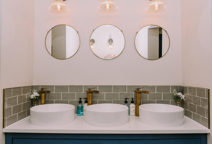 Three sinks with three mirrors