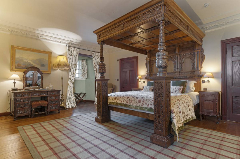 Bedroom with wooden four poster bed