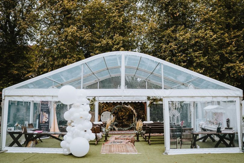 Clear wedding marquee with balloons