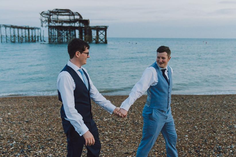 same sex couple at beach wedding